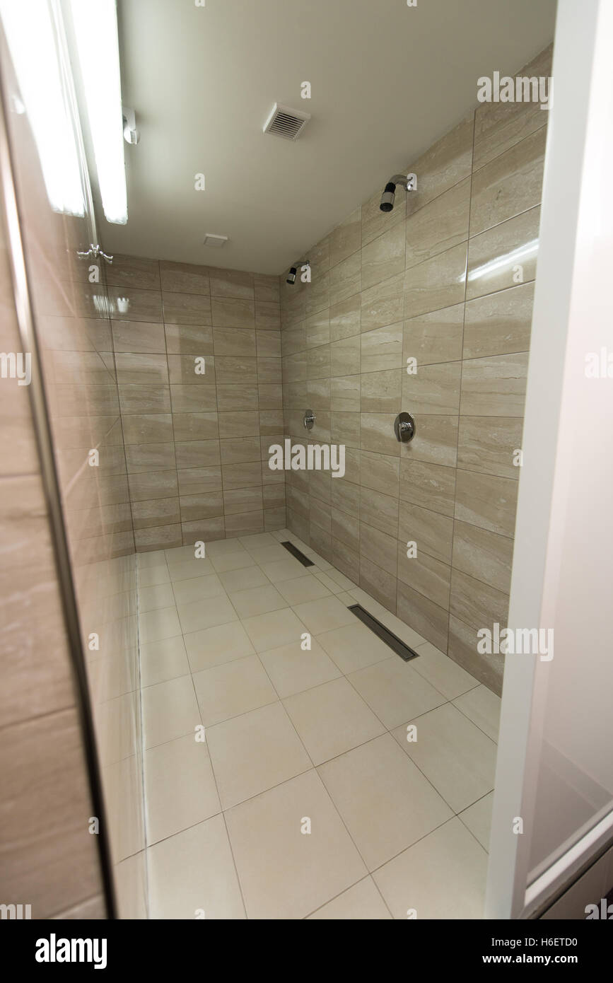 Modern interior of a shower room in fitness center gym stock photo
