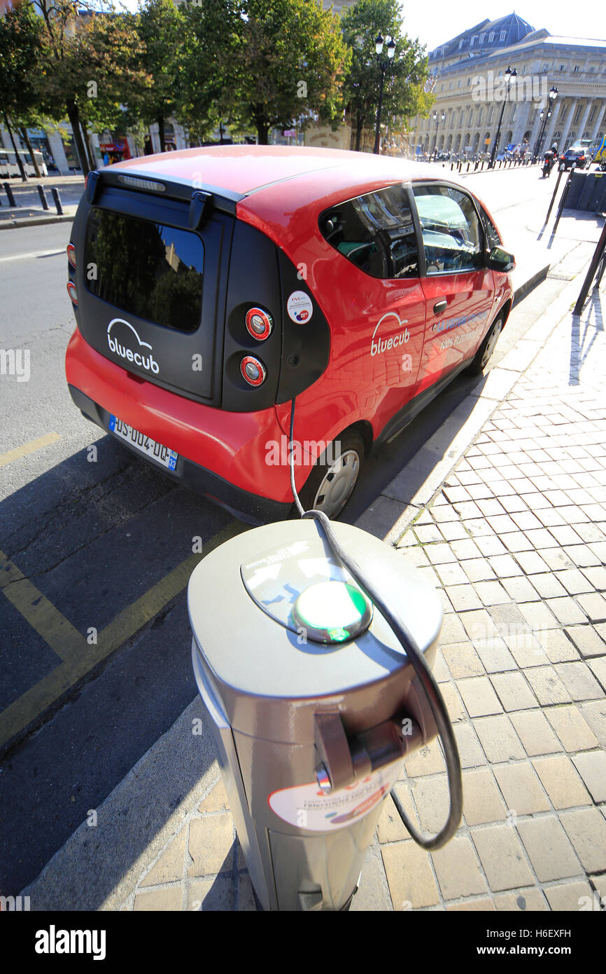 Electric car on charge in Bordeaux street in France - Stock Image