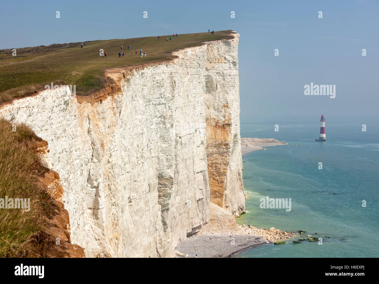 Beachy Head cliffs and lighthouse, East Sussex, on a hazy day - Stock Image