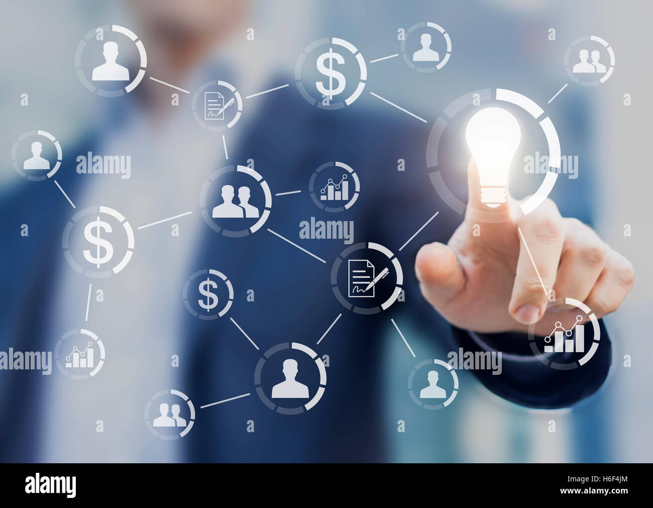 Concept about outsourcing, subcontracting or crowdsourcing solution. Businessman touching an idea button linked - Stock Image