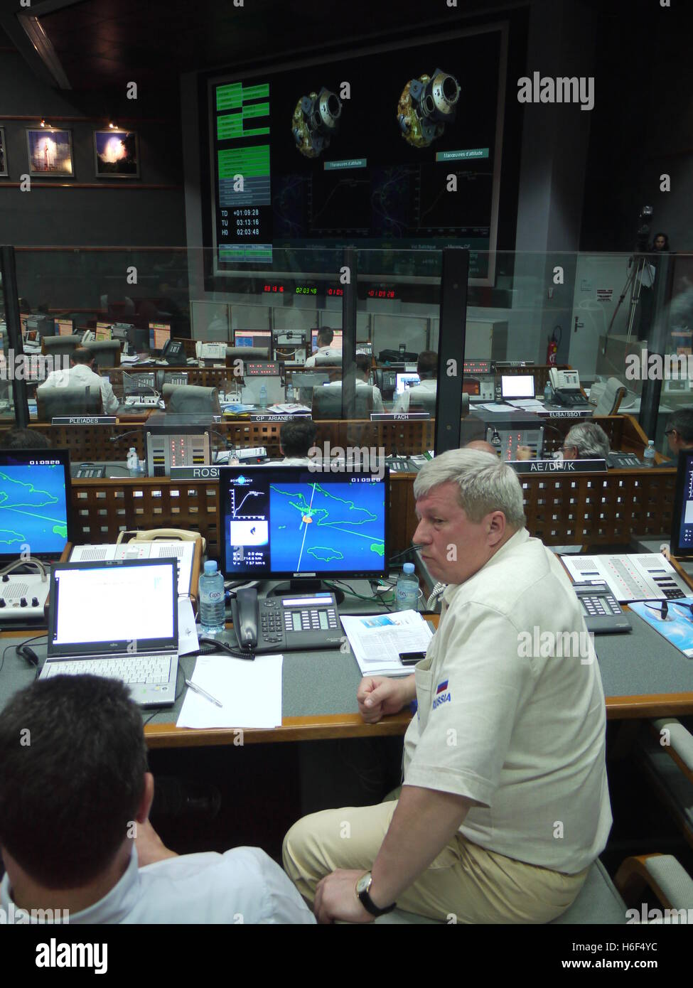 In French Guiana Space Centre, in Kourou, a russian flight engineer control the orbiting of a satellite with Soyuz - Stock Image