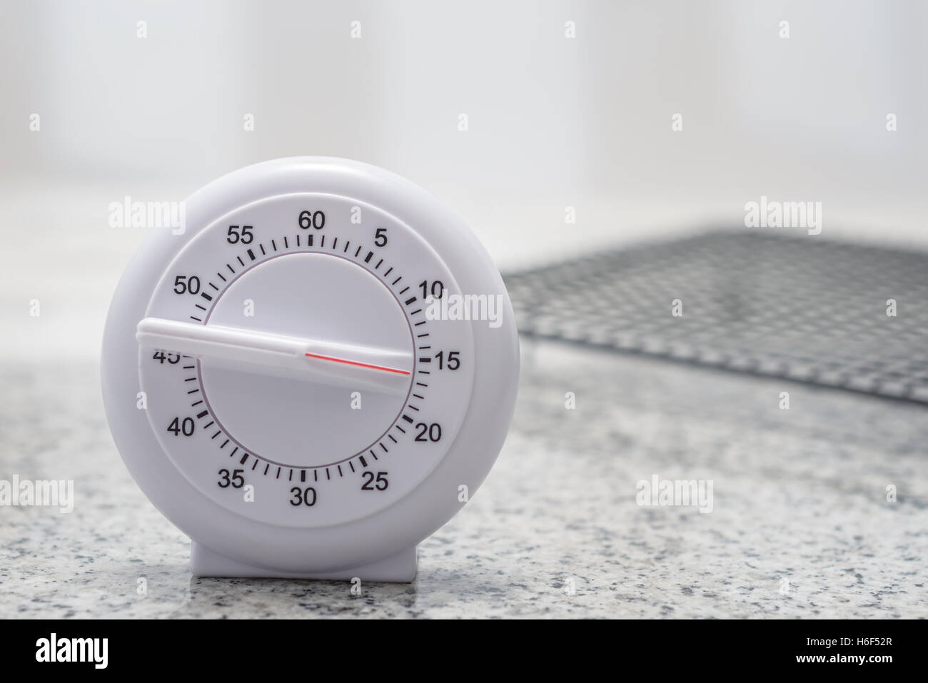 kitchen timer set for 15 minutes with cooling rack in the background