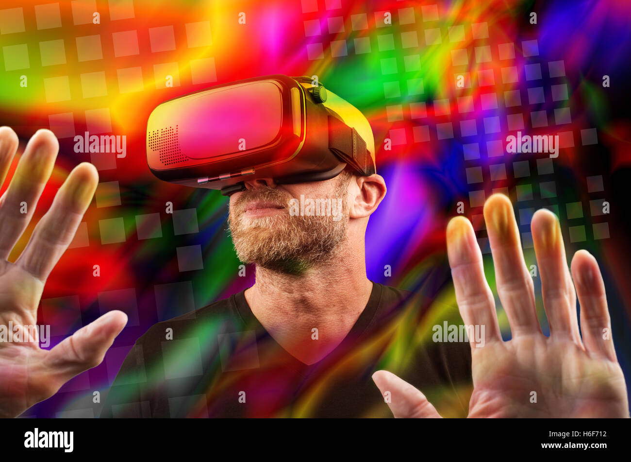 Man wearing VR headset and touching something with his hands (montage) - Stock Image