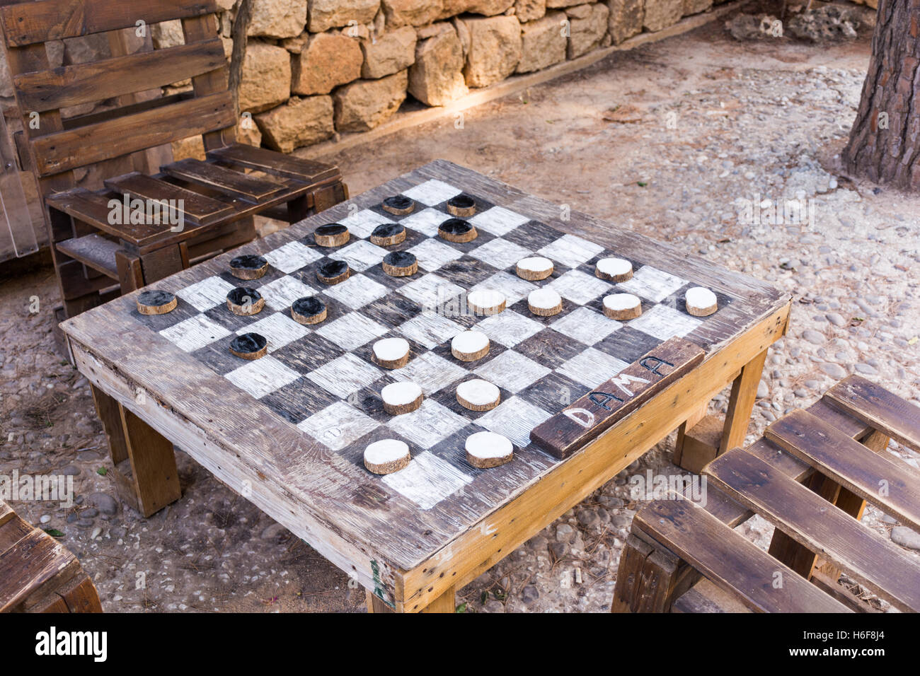The Board Games Checkers. All Of Wood, By Recycling Used Materials,  Ecological In The Garden, Can Be Used As A Table.