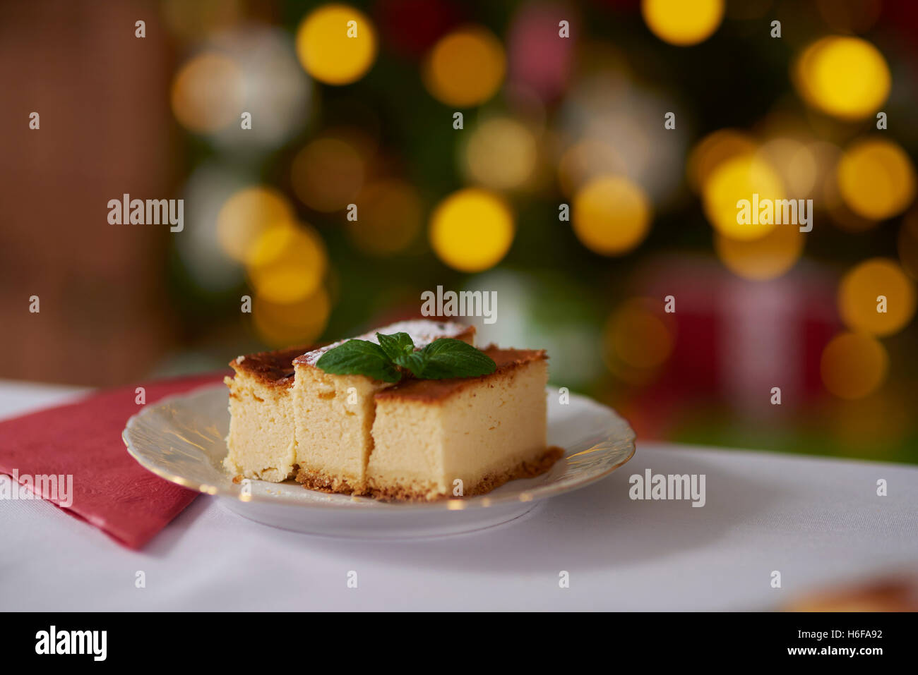 Cheesecake decorated with a mint leaf - Stock Image