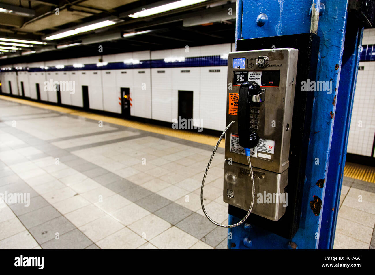 Payphone on the platform of the Canal St. subway station platform in Manhattan. - Stock Image