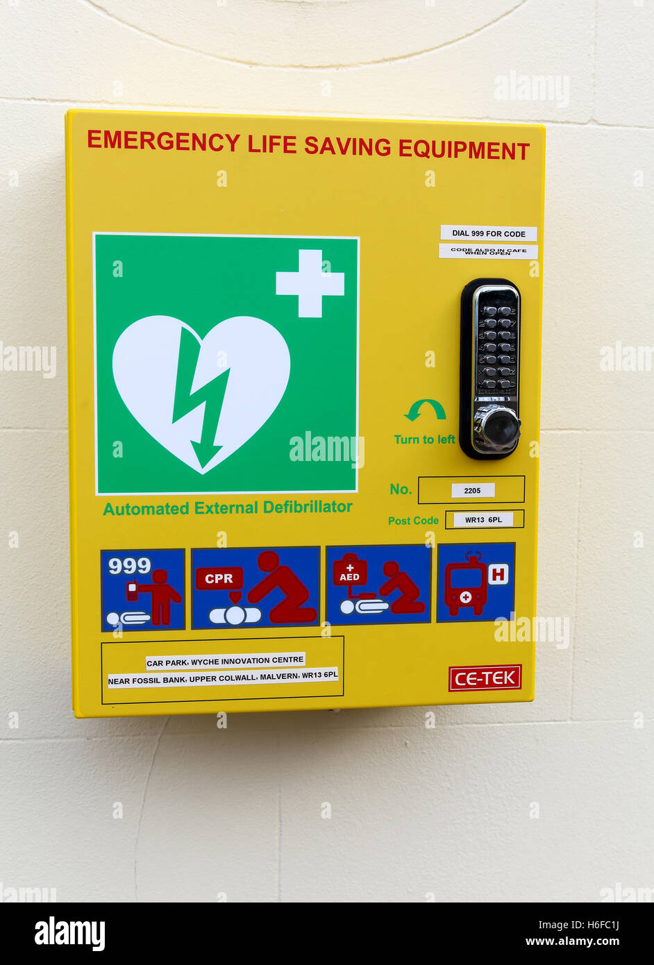 Defibrillator emergency life saving machine in a public place England UK - Stock Image