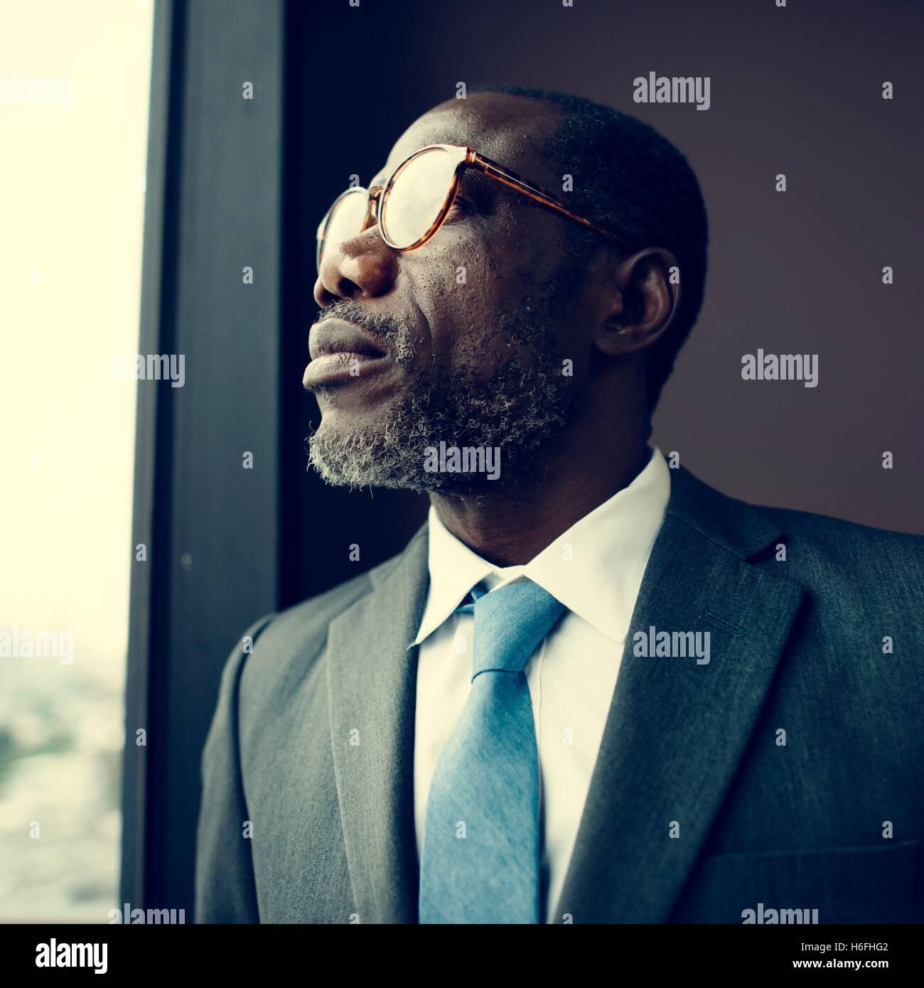 African Descent Businessman Contemplation Concept - Stock Image