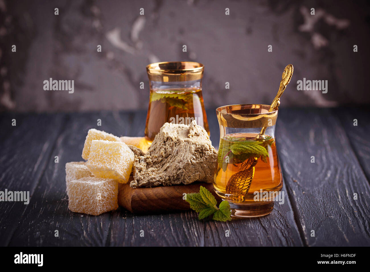 Arabic tea with turkish delight and halva. Selective focus - Stock Image