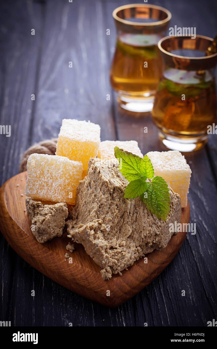 Turkish delight, halva and tea. Selective focus - Stock Image