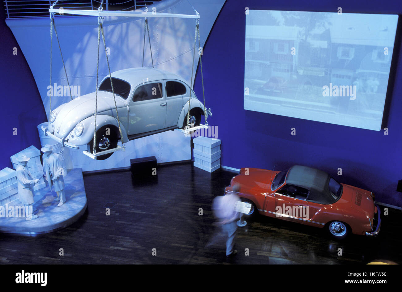 Germany, Wolfsburg, the Volkswagen Autostadt, old VW Beetle and a Karmann Ghia convertible. - Stock Image