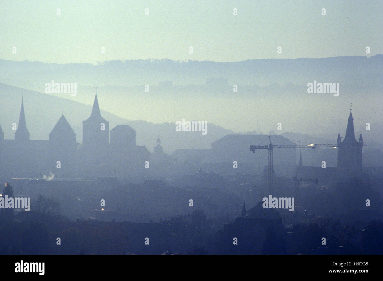 Germany, Trier, view from the Markus mountain to the city, early morning fog. - Stock Image
