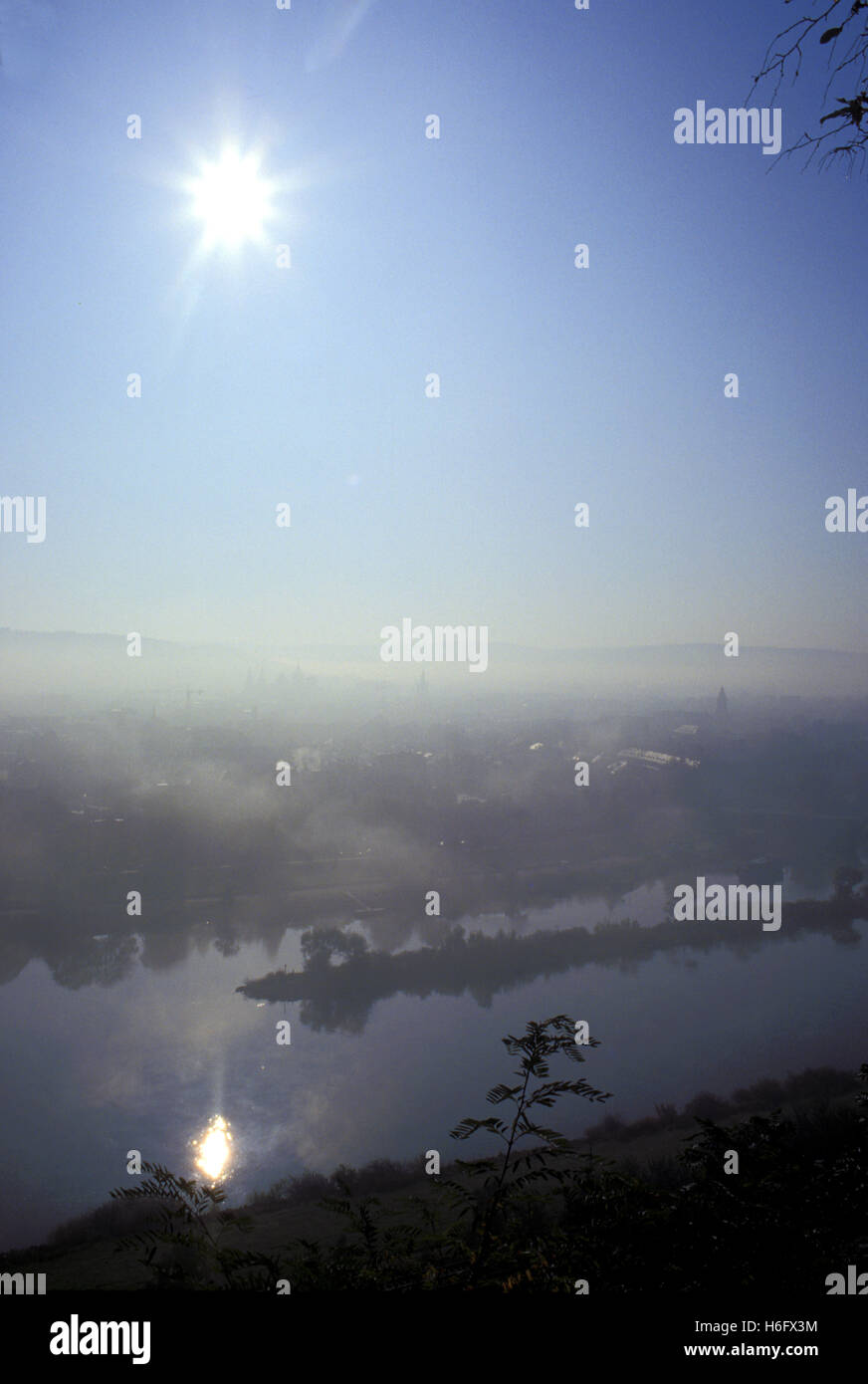 Germany, Trier, view from the Markus mountain to the city, early morning fog, river Moselle. - Stock Image