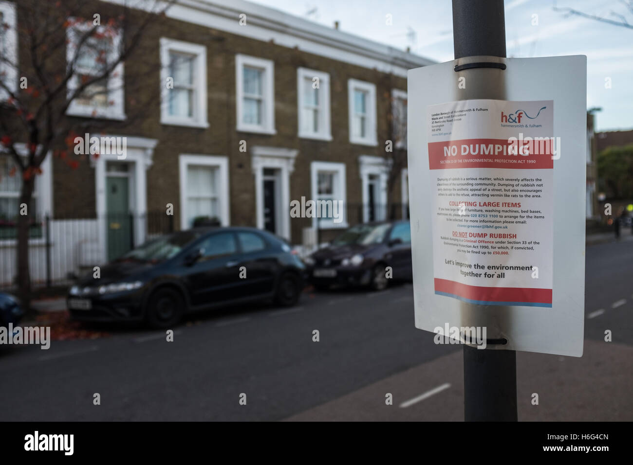 No Dumping sign on a lamppost in a Chelsea street - Stock Image