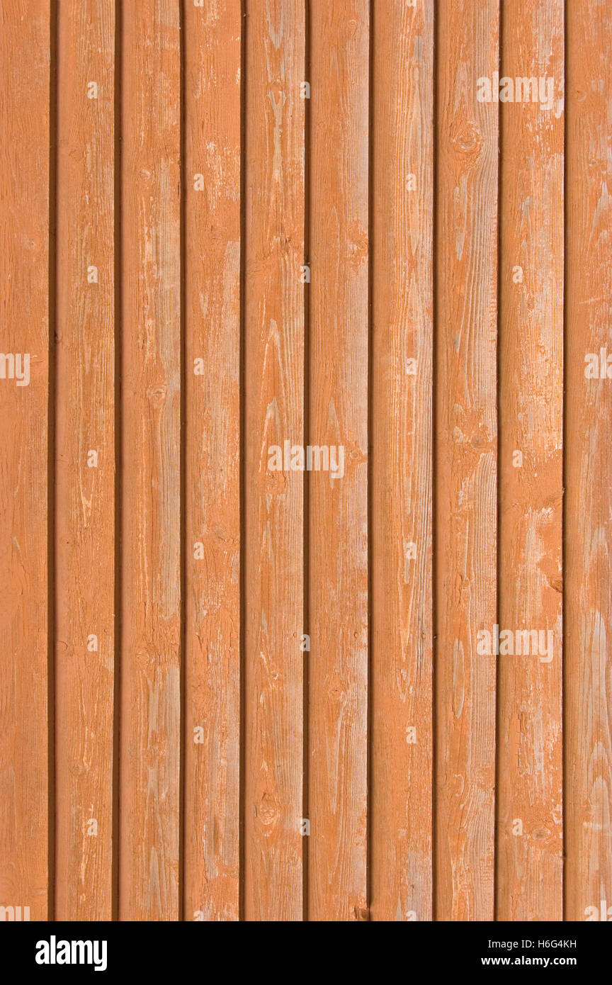 Natural old wood fence planks wooden close board texture overlapping bright reddish brown vertical terracotta background - Stock Image