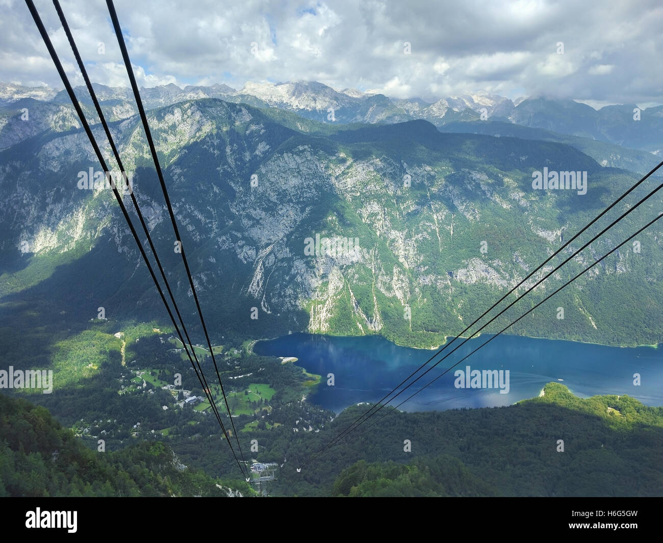 Cable car goes up to the top of the mountain Vogel in Bohinj, Slovenia - Stock Image