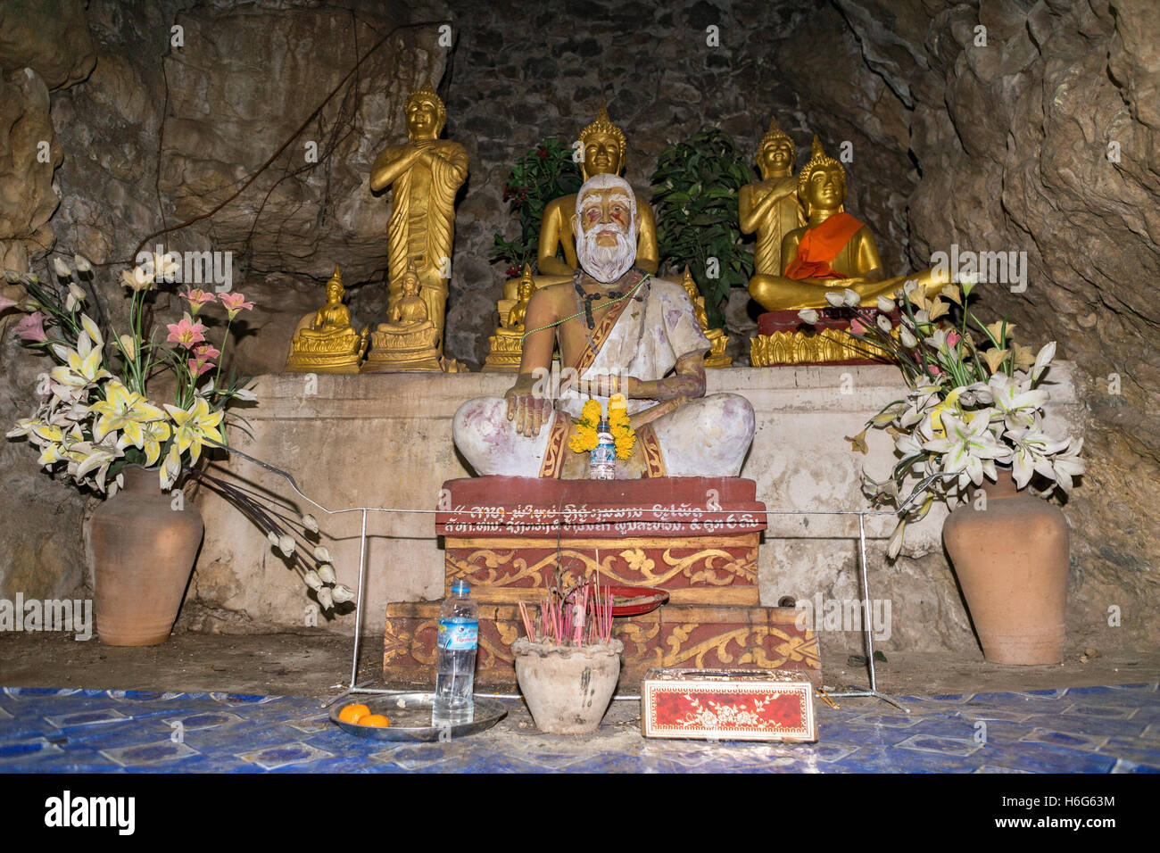 That Chomsi Temple Luang Prabang Laos - hermit who founded the temple - Stock Image