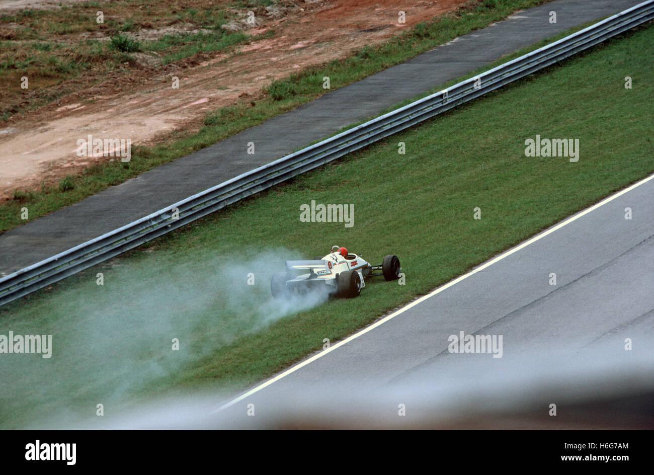Smoking car pulls off track at the Jacarepagua circuit, Rio de Janeiro - home of the Formula 1 Brazilian Grand Prix - Stock Image