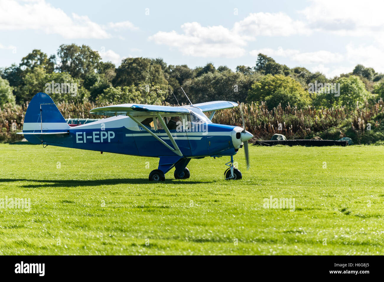 1960 Piper PA-22-160 Tri Pacer Aircraft preparing to take off. - Stock Image
