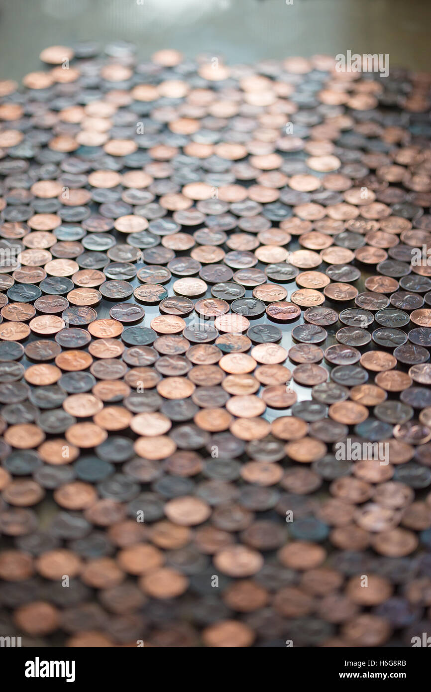 Large group of pennies with short depth of field for a background - Stock Image