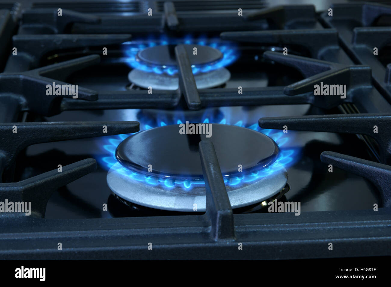 Two gas fueled rings on a domestic cooker or stove - Stock Image