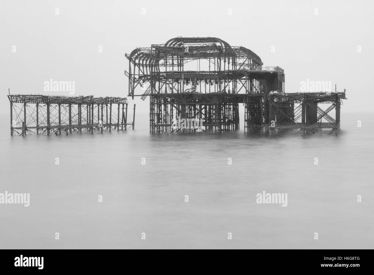 Black and white photograph of the remains of the west pier in Brighton Sussex United Kingdom - Stock Image
