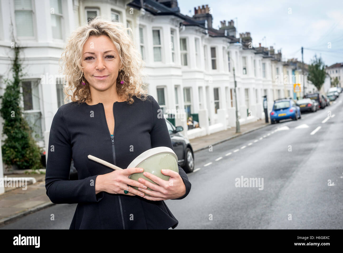 One-time Great British Bake-Off contestant Kate Henry at home in Brighton - Stock Image
