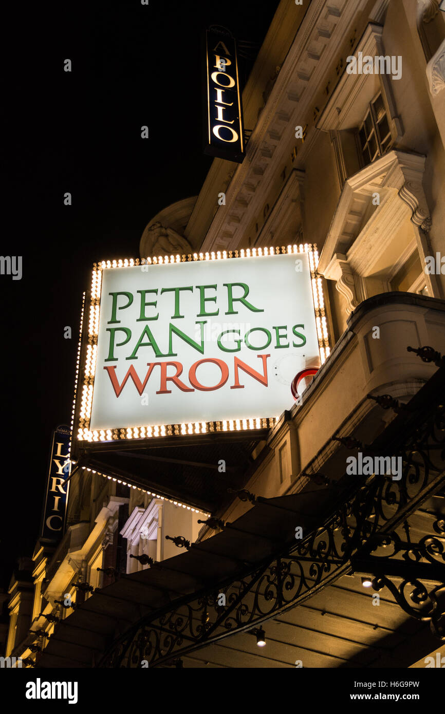 Signs advertising Peter Pan Goes Wrong at London's Apollo Theatre on Shaftesbury Avenue. - Stock Image