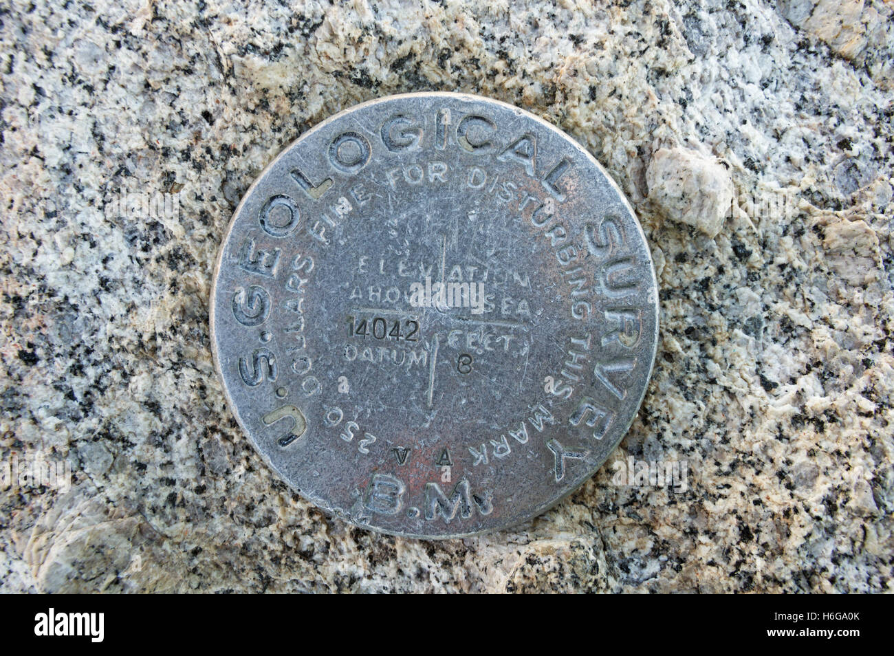 Mount Langley USGS bench mark with elevation 14042 ft marked - Stock Image