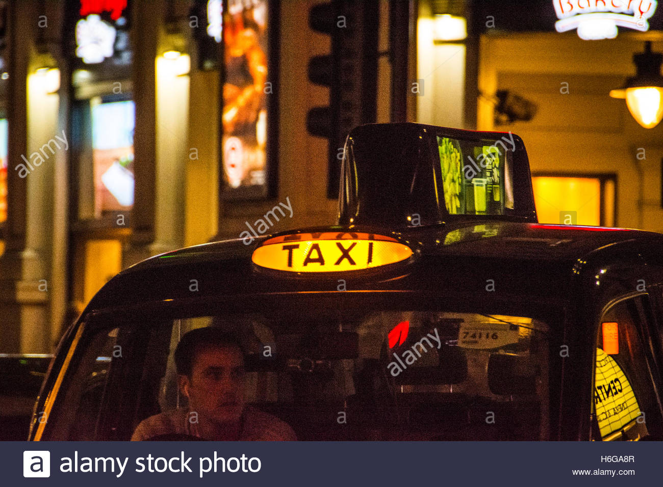 Black taxi cab sign in Chinatown, Soho, Central London, UK - Stock Image