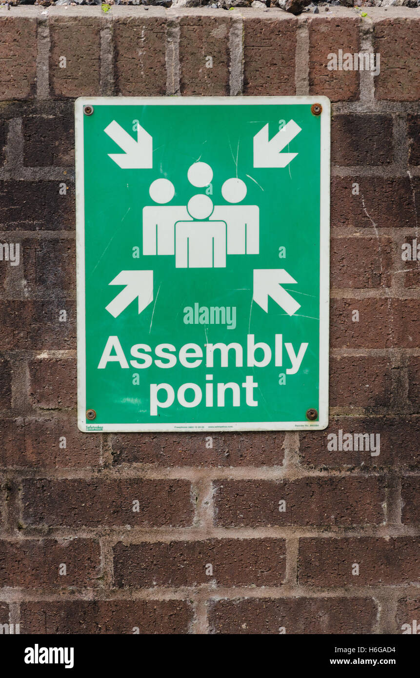 A sign designating an emergency assembly point. - Stock Image