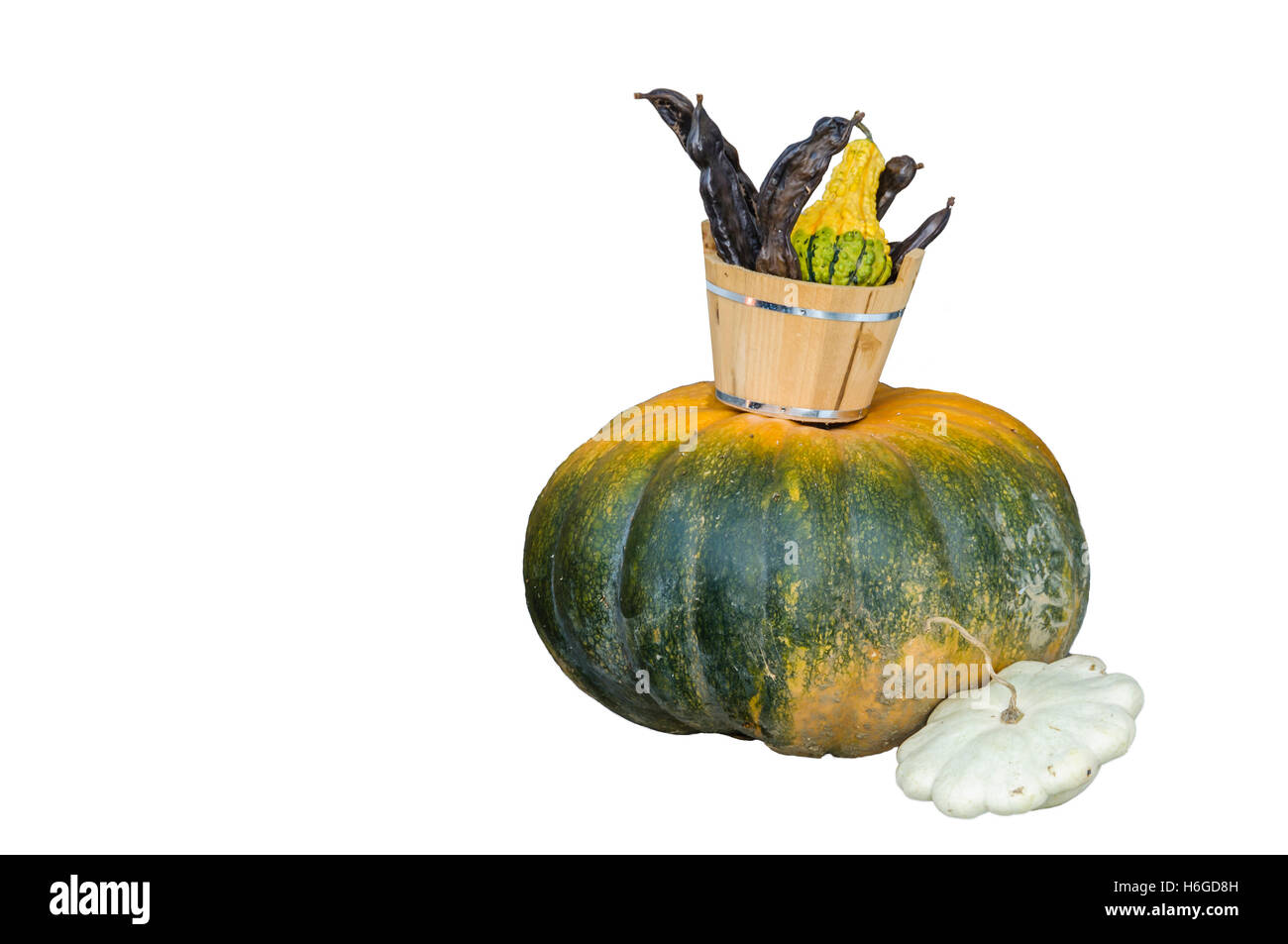 Pumpkins with autumn decoration, cut out on white background, copy space - Stock Image