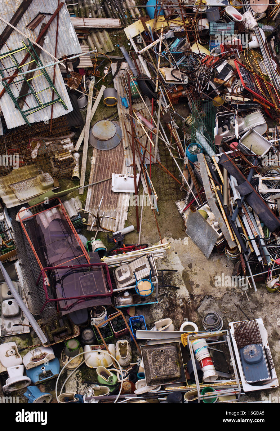 Top view of a junkyard with a chaotic load of wasted trash - Stock Image