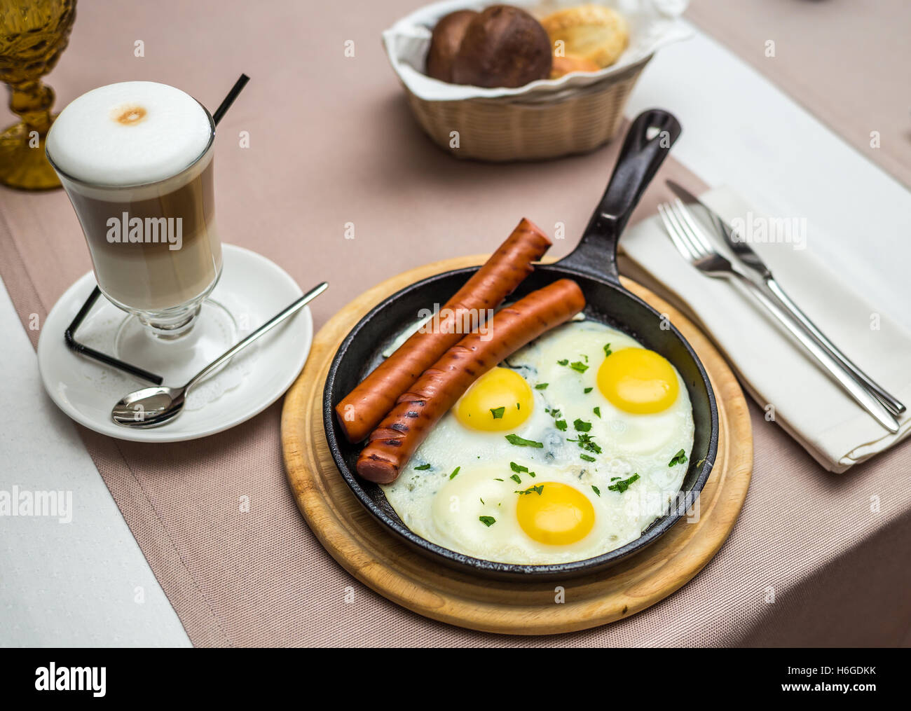 scrambled eggs with sausages - Stock Image