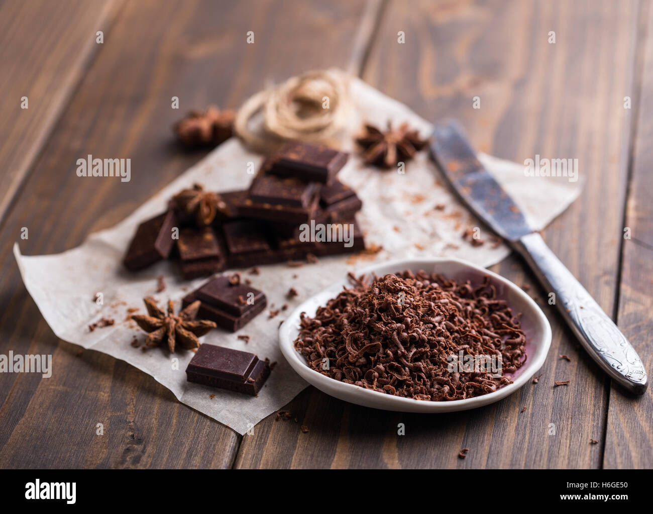 Heap of broken chocolate pieces and some grated chocolate - Stock Image