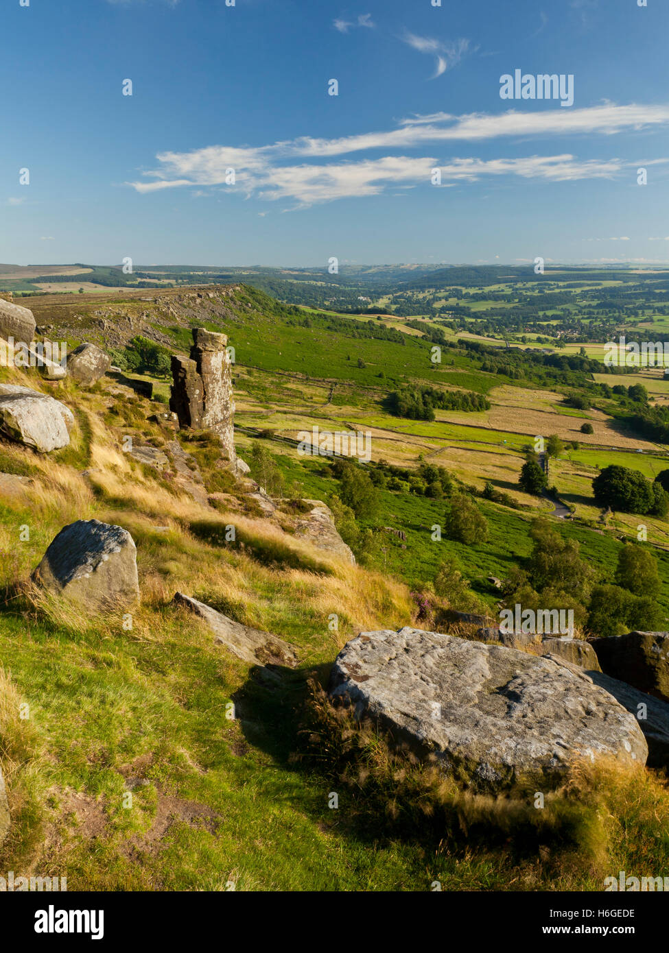 A view for miles of the surrounding countryside from Curbar Edge Ridge, Peak District, Derbyshire, UK - Stock Image