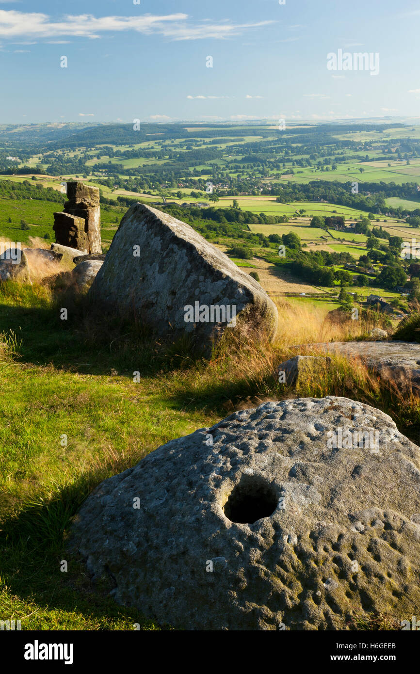 An adandoned grinding stone at Curbar Edge, Peak District, Derbyshire, England UK - Stock Image