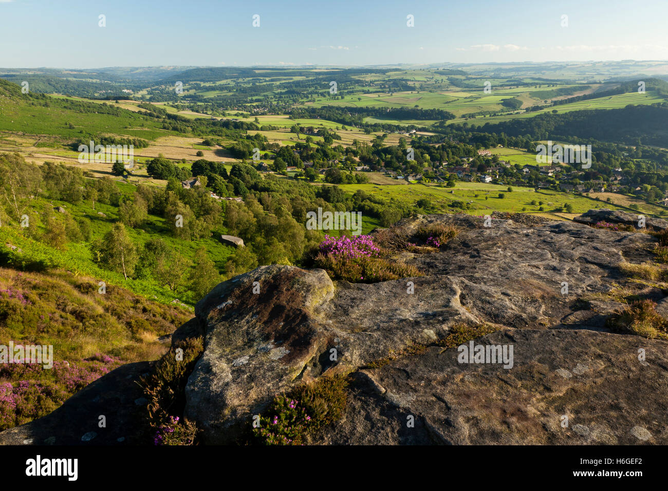 View of surrounding rural landscape of Baslow and Curbar from Curbar Edge, Derbyshire, England UK - Stock Image
