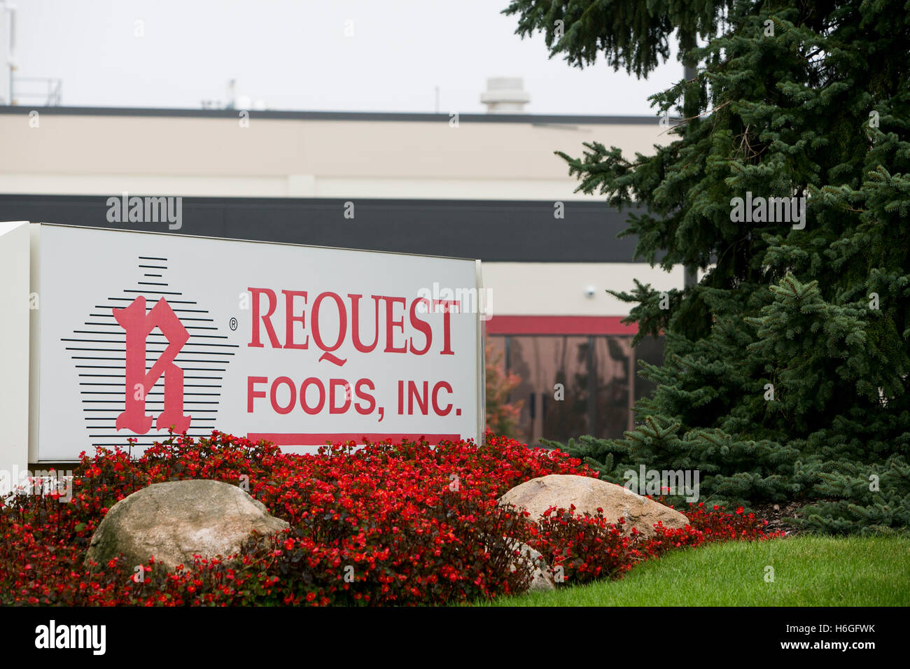 A logo sign outside of the headquarters of Request Foods, Inc., in Holland, Michigan on October 16, 2016. - Stock Image