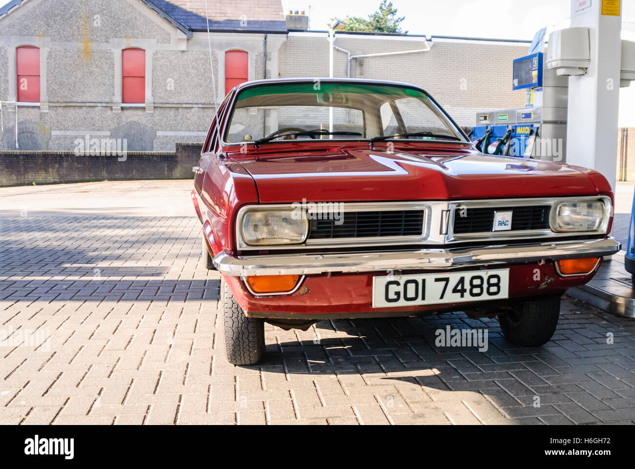 Red Vauxhall Viva HC parked at a petrol station. - Stock Image