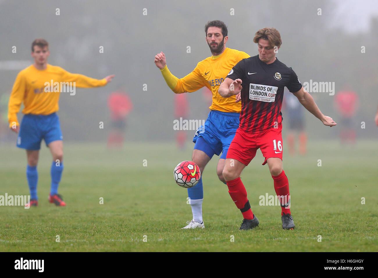 Mile End (yellow) vs Mustard, Hackney & Leyton Sunday League Football at Hackney Marshes on 30th October 2016 - Stock Image