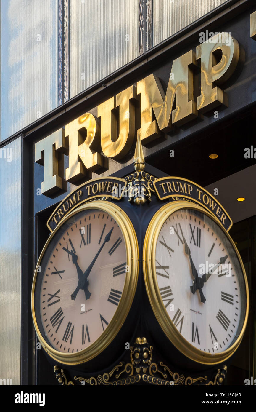 NEW YORK CITY - SEPTEMBER 3, 2016: Polished brass sign for Trump Tower shines above branded clocks on Fifth Avenue. - Stock Image