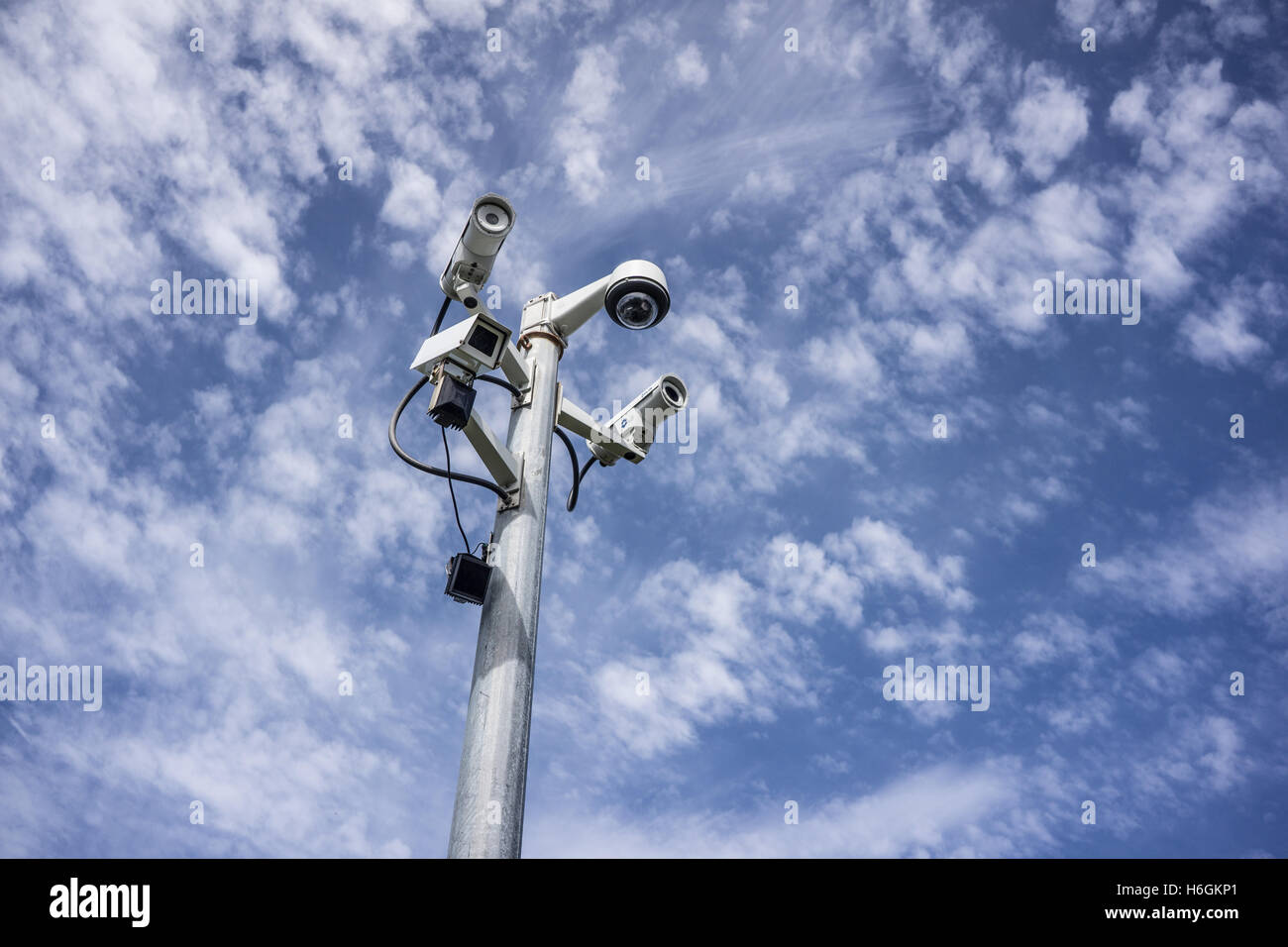 A mast bristling with different types of surveillance cameras - Stock Image