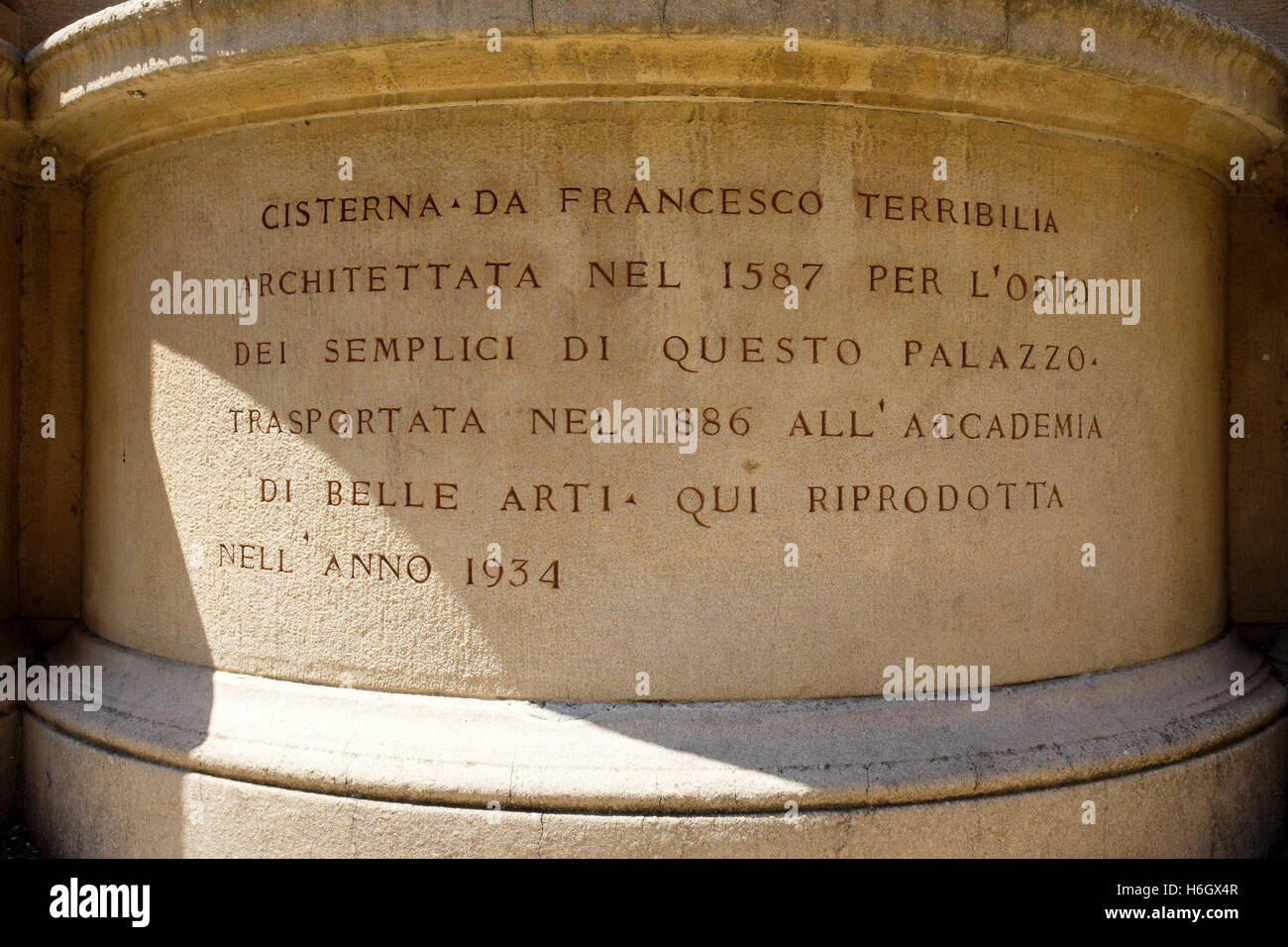 The wishing well, within the courtyard of the Palazzo d'Accursio, home to the Municipal Art Collection of Bologna, Stock Photo