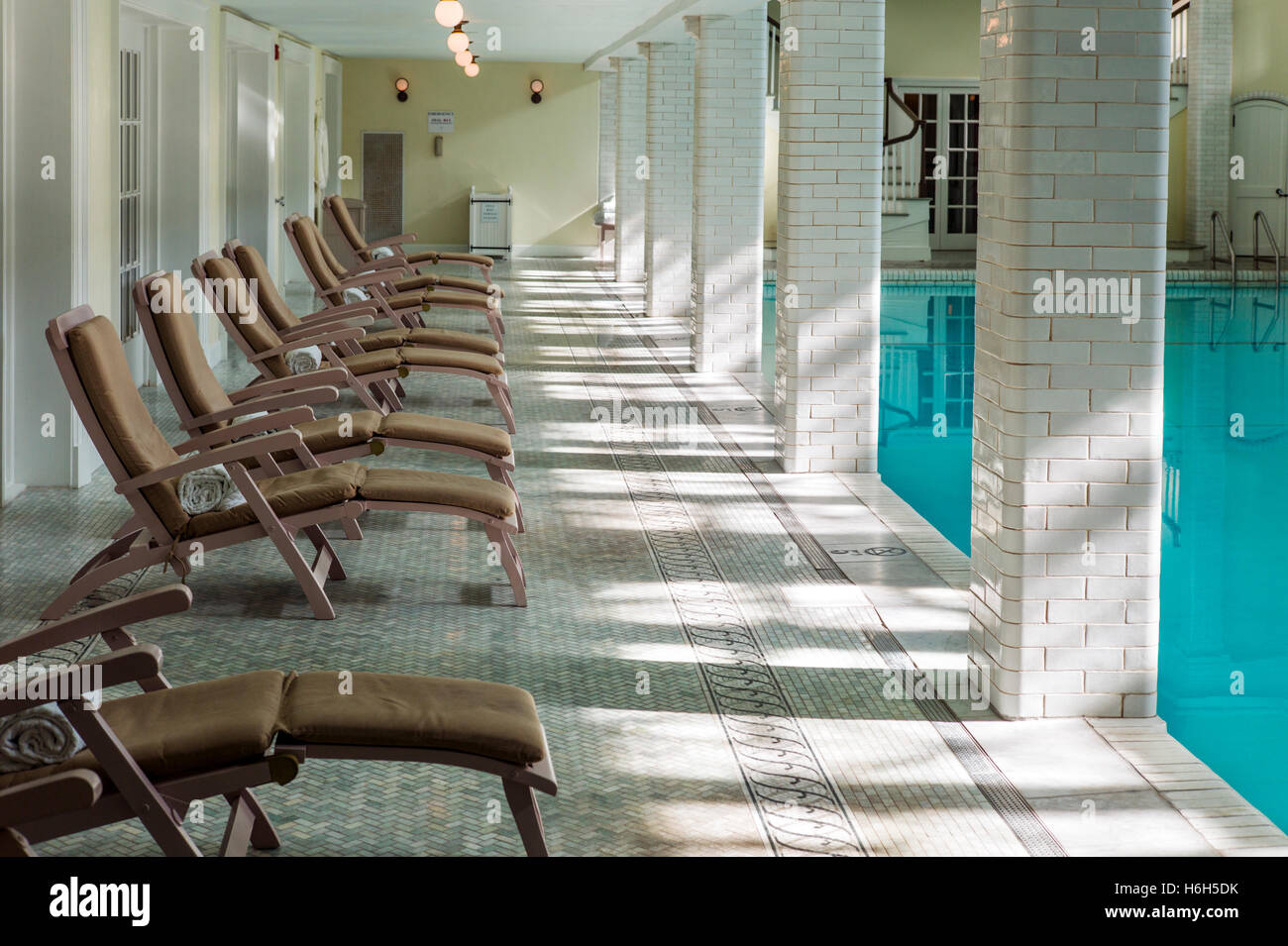 Chaise Lounges; interior spring-fed swimming pool; Omni Bedford Springs Resort & Spa; Bedford; Pennsylvania; - Stock Image