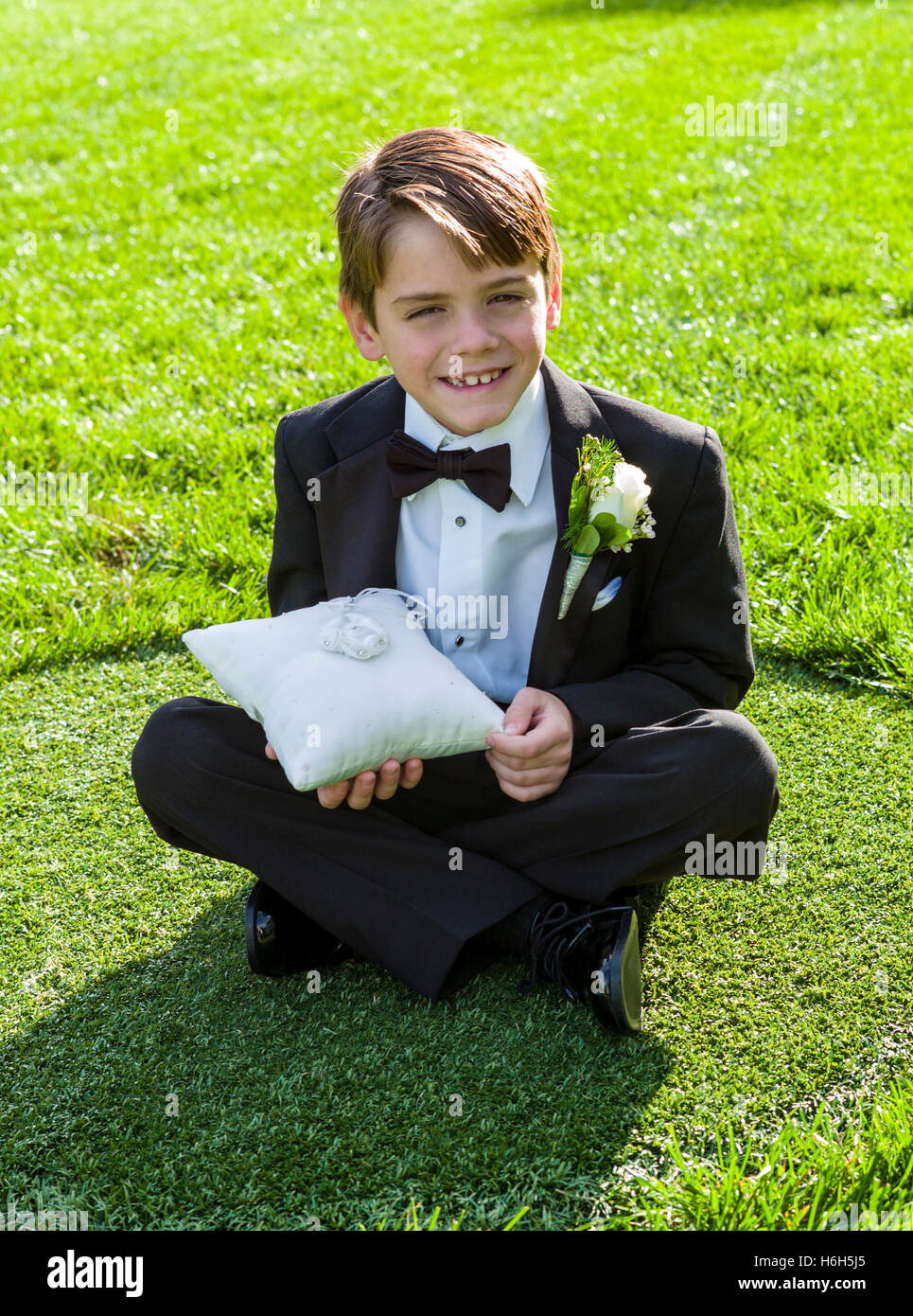 Young ring bearer boy in tuxedo waiting in gardens; Omni Bedford Springs Resort & Spa; Bedford; Pennsylvania; - Stock Image