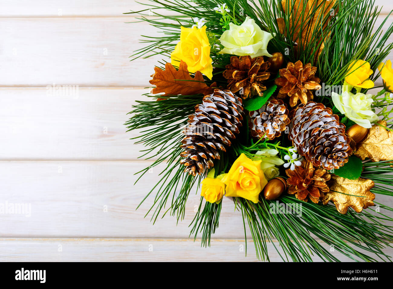 Christmas Background With Yellow Silk Roses And Golden Pine Cones Party Decoration Greeting