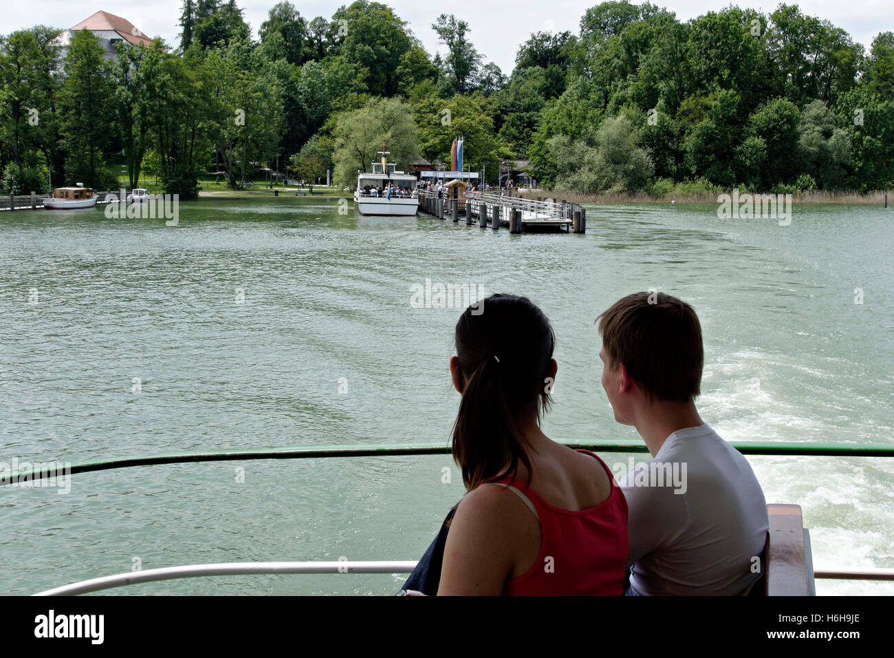 View to the Herrenchiemsee  ( Herreninsel ) from a ferry boat, Chiemsee Chiemgau, Upper Bavaria Germany Europe Stock Photo