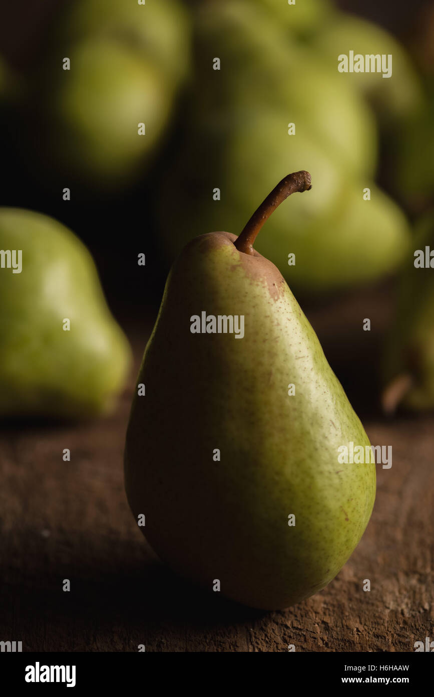 Still life of ripe Bartlett pears in subdued lighting - Stock Image