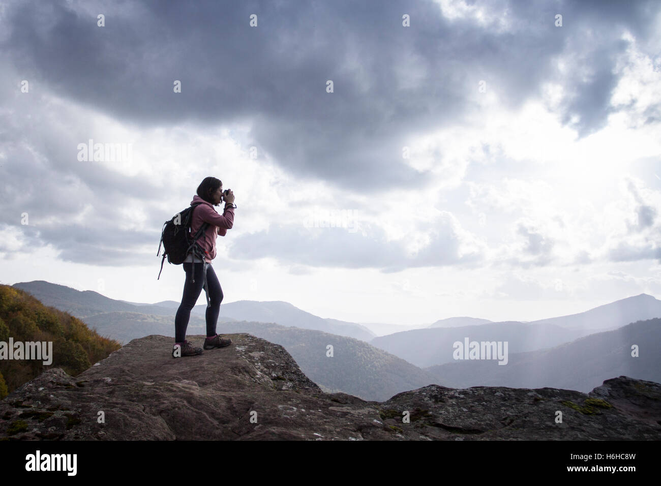 Woman backpacker in Zamariain viewer, Navarre, Spain. - Stock Image